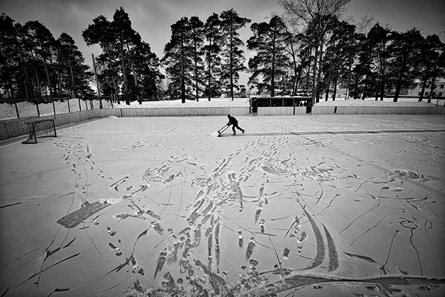 Vetluga's Hockey - Vladimir Pesnya - Team coach Evgeny Solovyov prepares the stadium for a match.