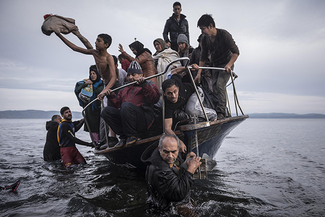 Reporting Europe's Refugee Crisis - Sergey Ponomarev - Refugees arrive by boat on the Greek island of Lesbos.